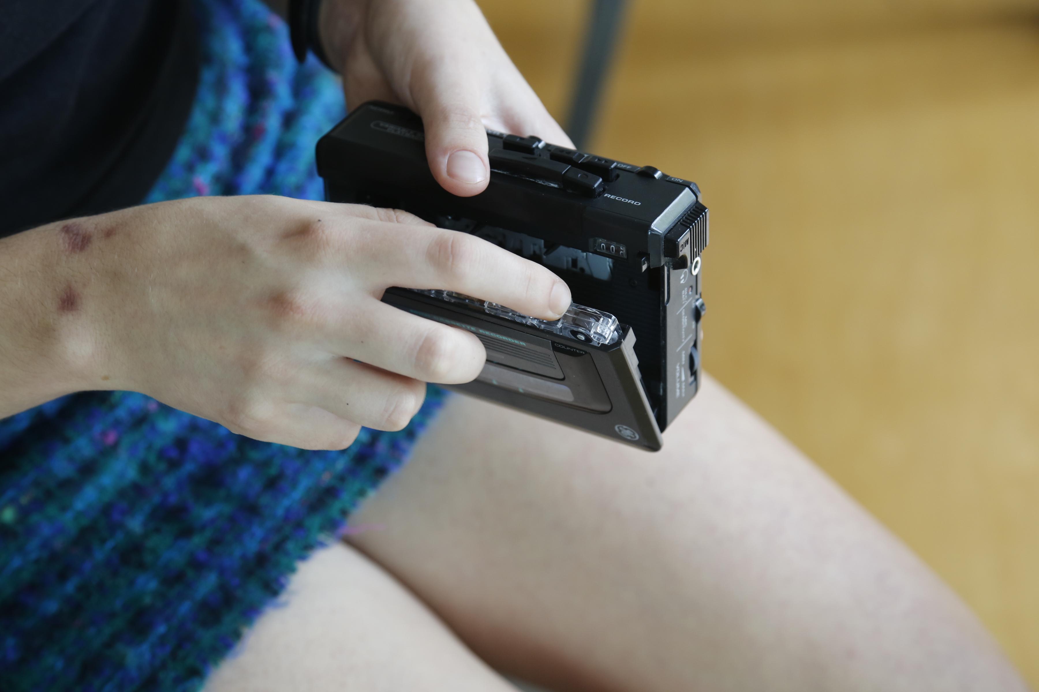 Clara Lou Inserting A Cassette In Tape Deck